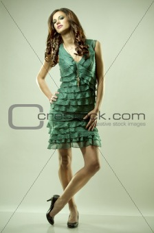 brunette and green dress