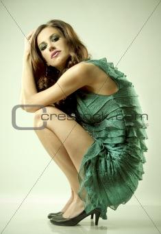 brunette and green dress