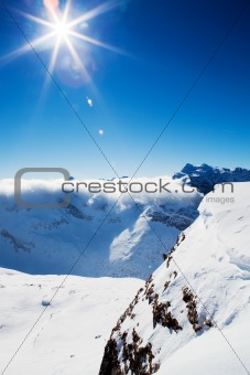 Sun and clouds over mountains