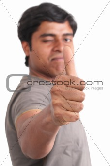 Portrait of happy young indian giving thumbs up
