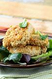 fried chicken in sesame seeds with salad