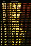 An electronic airport airplane departures board.