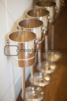 Champagne buckets in a row
