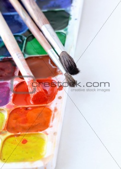 watercolor paints and brushes- the concept of Art
