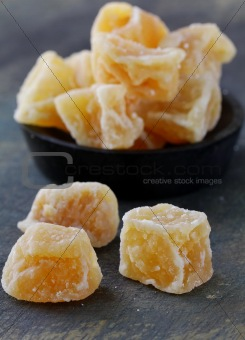 candied ginger on a dark background