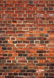 Colorful old English red brick wall background.