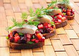 Sandwiches with rye bread, herring and vegetables