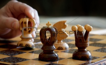 chess play with focus to black king in front
