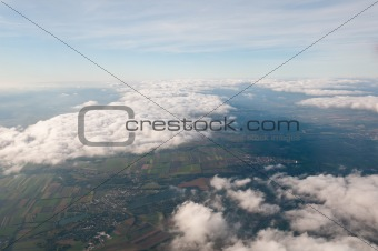 Beautiful view above cloudscape and fields