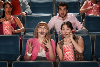 Amazed People In Theater