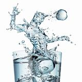 Glass of water with a splash shaped as a soccer player jumping a