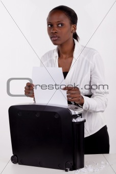 South African woman shredding a document