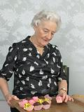 Senior woman with cup cakes