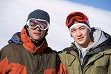 Two snowboarders