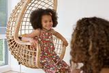 Girl in a wicker chair