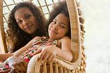 Mother and daughter in wicker chair
