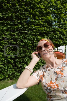 Senior woman on cellphone in garden