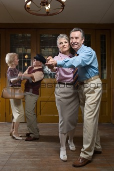 Two senior couples dancing
