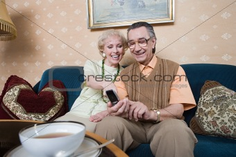 Senior couple looking at cellphone