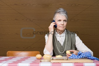 Woman with cellphone and potatoes