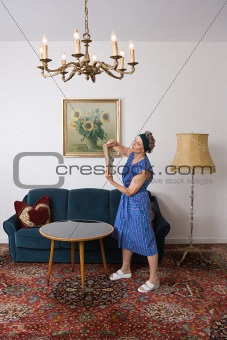 Senior woman dusting