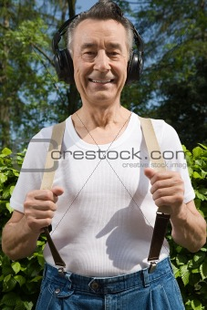 Man wearing headphones and stretching suspenders