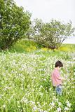 Boy standing in an overgrown field
