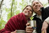 Mature couple drinking from metallic cups