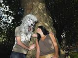 Young couple playing with halloween mask
