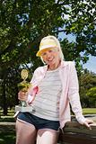 Senior adult woman holding a trophy