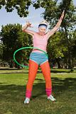 Senior adult woman playing with hula hoop