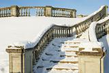 A snow-bound stone stair is in a winter park