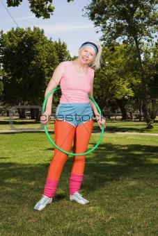Senior adult woman holding hula hoop