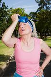 Senior adult woman cooling off during exercise