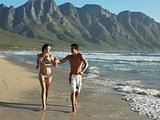 Couple jogging by the sea