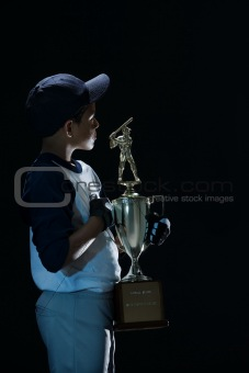 Boy holding a baseball trophy