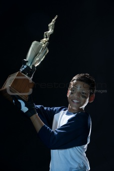 Boy with baseball trophy