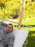 Mid adult man lying in a hammock
