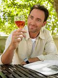 Mature adult man admiring a glass of wine