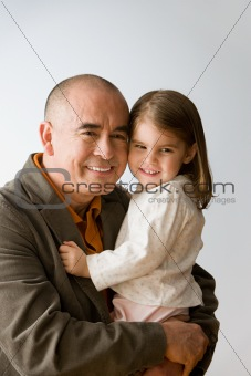 Grandfather hugging granddaughter