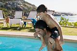 Father and son playing in swimming pool
