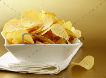 potato chips in a white bowl