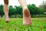 man's feet  running on the grass