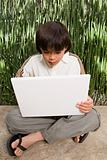 Boy with laptop computer