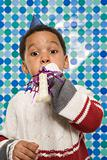 Boy with party horn blower