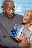 Senior couple with christmas gift
