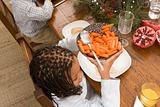 Girl with bowl of carrots
