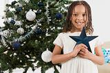 Girl holding a christmas star