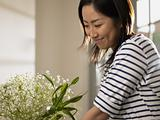 Woman looking at flower arrangement