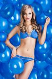 swimsuit and balloons in blue, she has an actractive expression